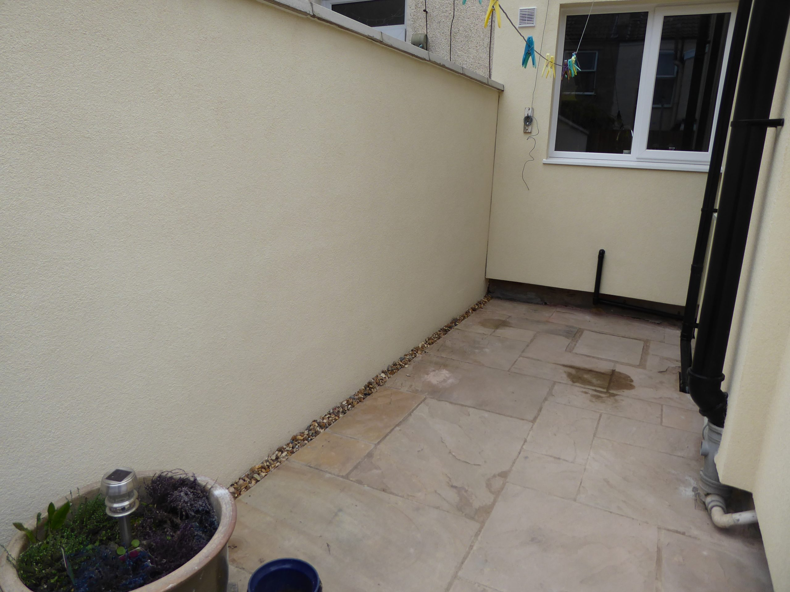 After (rear garden wall done using the same render finish)